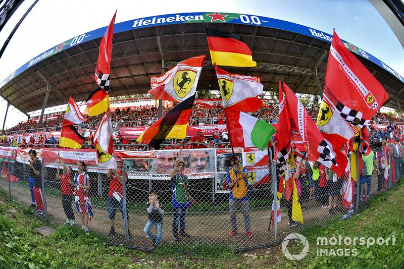 Ferrari fans wave their flags