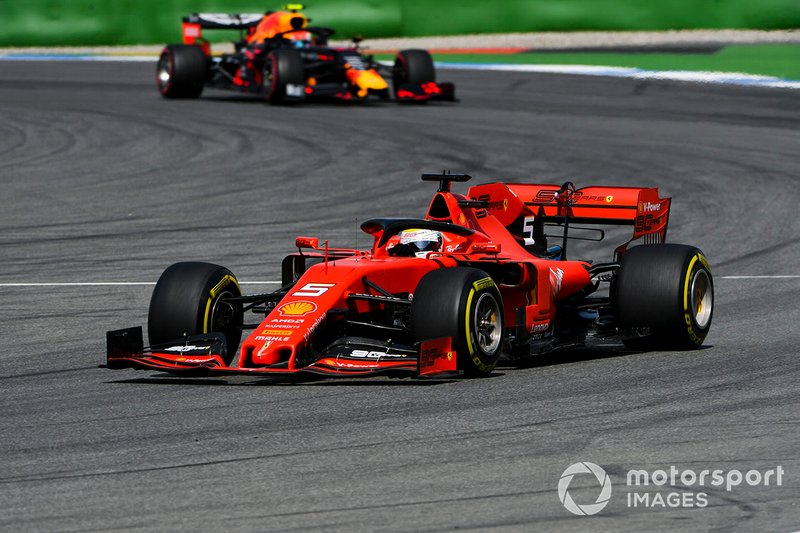 Sebastian Vettel, Ferrari SF90, leads Pierre Gasly, Red Bull Racing RB15