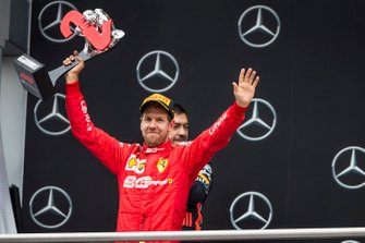 Sebastian Vettel, Ferrari, 2nd position, with his trophy