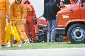 Marshals attend Gerhard Berger's Ferrari 640 after an accident