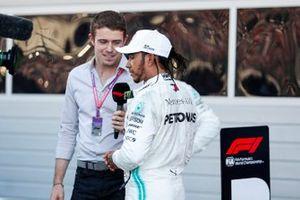 Race winner Lewis Hamilton, Mercedes AMG F1, celebrates in parc ferme and talks to Paul di Resta
