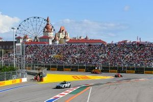 The Safety Car leads Sebastian Vettel, Ferrari SF90, and Charles Leclerc, Ferrari SF90