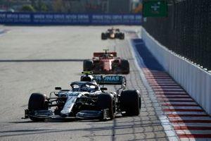 Valtteri Bottas, Mercedes AMG W10, leads Charles Leclerc, Ferrari SF90