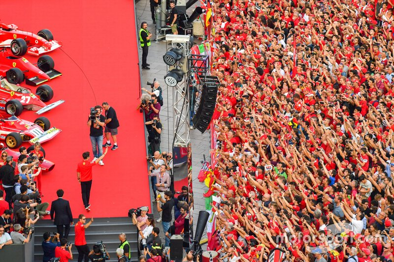 Charles Leclerc, Ferrari and Sebastian Vettel, Ferrari wave to the crowd as they take to the stage