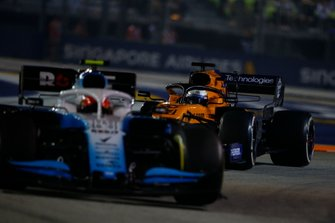 Robert Kubica, Williams FW42, leads Carlos Sainz Jr., McLaren MCL34
