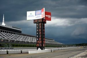 The race ended on lap 128 with impending storms about the hit the track.