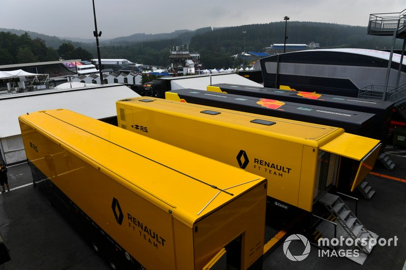 Renault and Red Bull motorhomes and transporters in the paddock
