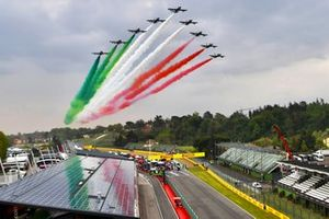Frecce Tricolri fly over the grid in their Aermacchi MB339A jet trainers prior to the start