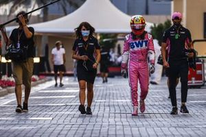 Sergio Perez, Racing Point, walks back after retiring