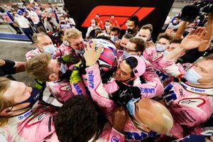Sergio Perez, Racing Point, 1st position, celebrates with his team in Parc Ferme