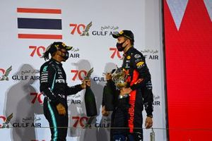 Lewis Hamilton, Mercedes-AMG F1, 1st position, and Alex Albon, Red Bull Racing, 3rd position, on the podium