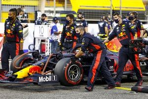 Car of Alex Albon, Red Bull Racing RB16 being pushed by mechanics