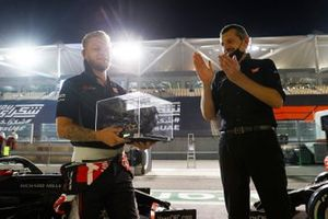 The Haas team make a presentation to Kevin Magnussen, Haas F1, ahead of his last race. Guenther Steiner, Team Principal, Haas F1, gifts Magnussen a Formula 1 steering wheel