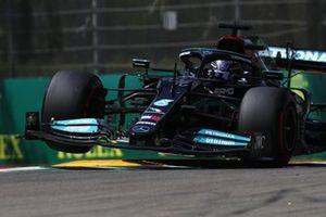 Lewis Hamilton, Mercedes W12, lifts a wheel