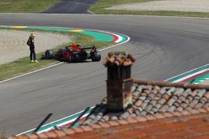 Sergio Perez, Red Bull Racing RB16B, looks at his car after stopping on track