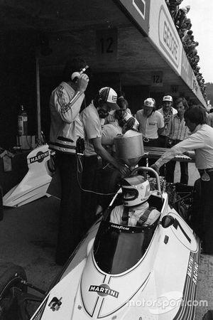 Carlos Reutemann's Brabham BT44B Ford is fuelled up in the pits as Bernie Ecclestone and Gordon Murray look on