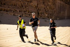 Johan Kristoffersson, Rosberg X Racing, and Molly Taylor, Rosberg X Racing, run the course with a member of the team