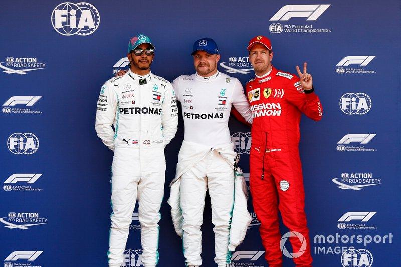 Lewis Hamilton, Mercedes AMG F1, Pole Sitter Valtteri Bottas, Mercedes AMG F1 and Sebastian Vettel, Ferrari in Parc Ferme