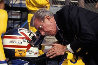 Jean-Marie Balestre speaks to Nigel Mansell as he sits in his Williams FW14B Renault on the grid