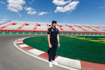 Lance Stroll, Racing Point, walks the track, and passes the Lance Stroll grandstand