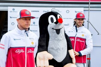 Kimi Raikkonen, Alfa Romeo Racing and Antonio Giovinazzi, Alfa Romeo Racing poses for a photograph with a mole