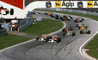 Ayrton Senna, Mclaren MP4-4 leads team mate Alain Prost, Mclaren MP4-4