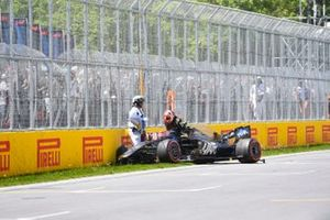 Kevin Magnussen, Haas VF-19, climbs out of his damaged car at the end of Q2