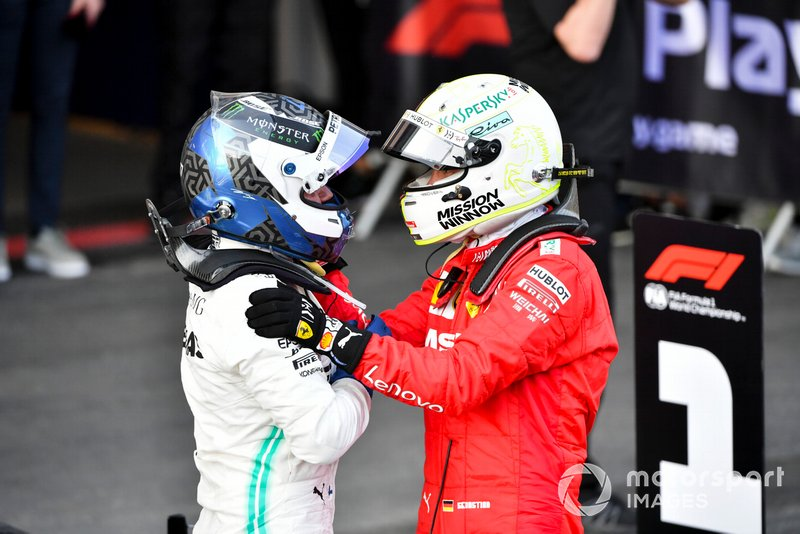 Sebastian Vettel, Ferrari, terzo, fa i complimenti a Valtteri Bottas, Mercedes AMG F1, vincitore, al Parco Chiuso