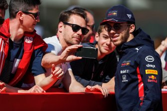 Pierre Gasly, Red Bull Racing poses for a selfie with a fan
