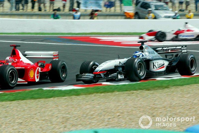 Michael Schumacher, Ferrari F2002; Kimi Räikkönen, McLaren MP4-17