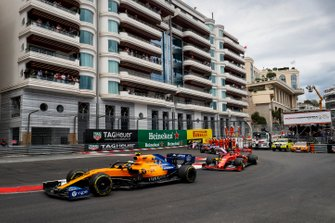 Lando Norris, McLaren MCL34, leads Charles Leclerc, Ferrari SF90, and Lance Stroll, Racing Point RP19
