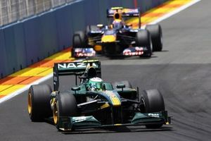 Heikki Kovalainen, Lotus T127 leads Mark Webber, Red Bull Racing RB6