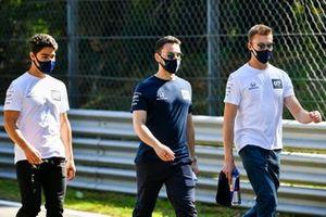 Daniil Kvyat, AlphaTauri, and Sergio Sette Camara, AlphaTauri, walk the track