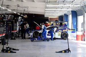 Crew members work on Chase Elliott's Hendrick Motorsports Chevrolet Camaro after an on-track incident