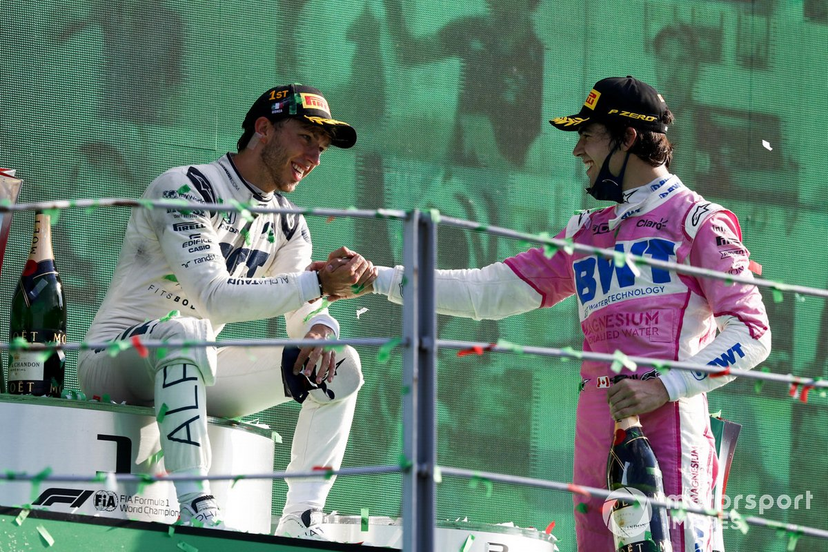 Pierre Gasly, AlphaTauri, 1st position, and Lance Stroll, Racing Point, 3rd position, congratulate each other on the podium