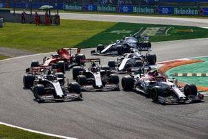 Antonio Giovinazzi, Alfa Romeo Racing C39, Romain Grosjean, Haas VF-20, Kevin Magnussen, Haas VF-20, George Russell, Williams FW43, Sebastian Vettel, Ferrari SF1000, and Nicholas Latifi, Williams FW43, at the start