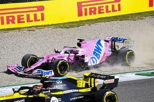Sergio Perez, Racing Point RP20, in the gravel as Esteban Ocon, Renault F1 Team R.S.20, passes