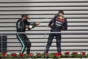 Race Winner Lewis Hamilton, Mercedes-AMG F1 celebrates on the podium with Max Verstappen, Red Bull Racing and the champagne