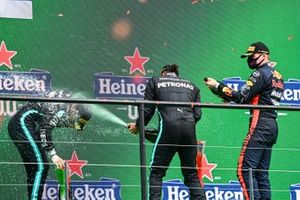 Valtteri Bottas, Mercedes-AMG F1, 2nd position, Lewis Hamilton, Mercedes-AMG F1, 1st position, and Max Verstappen, Red Bull Racing, 3rd position, spray Champagne on the podium