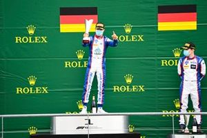 Race Winner Lirim Zendeli, Trident and dm celebrate on the podium with the trophy