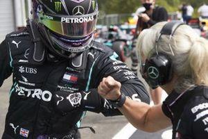 Pole man Lewis Hamilton, Mercedes-AMG Petronas F1, celebrates in Parc Ferme with his physio Angela Cullen in Parc Ferme