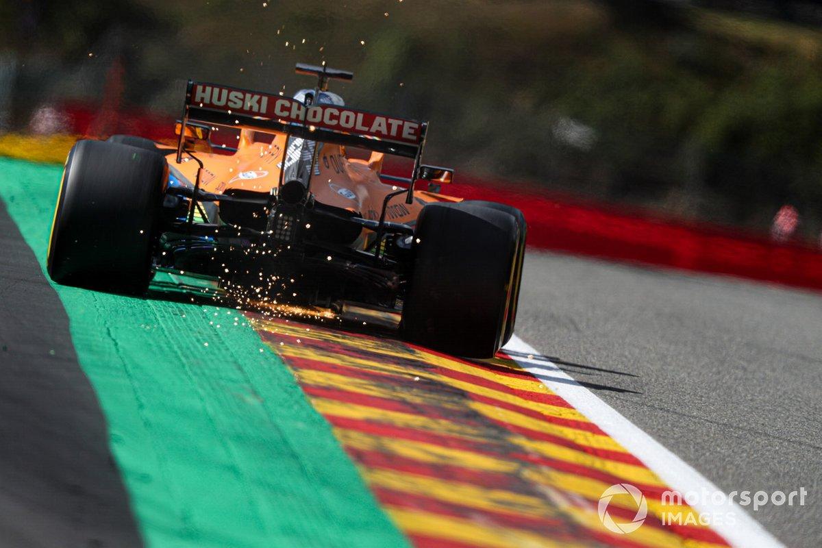 Carlos Sainz Jr., McLaren MCL35, kicks up some sparks