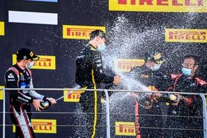 Christian Lundgaard, ART Grand Prix, 1st position, Louis Deletraz, Charouz Racing System, 2nd position, and Juri Vips, Dams, 3rd position, celebrate with Champagne on the podium