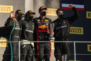 Valtteri Bottas, Mercedes-AMG F1, 2nd position, Lewis Hamilton, Mercedes-AMG F1, 1st position, Alex Albon, Red Bull Racing, 3rd position, and the Mercedes trophy delegate on the podium