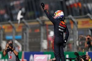 Pole man Max Verstappen, Red Bull Racing, waves to fans from Parc Ferme