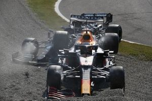 Max Verstappen, Red Bull Racing RB16B, and Lewis Hamilton, Mercedes W12, collide and crash out of the race