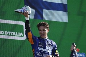 Lando Norris, McLaren, 2nd position, performs a shoey with his team mates boot on the podium