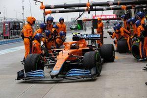 Lando Norris, McLaren MCL35M, leaves his pit box