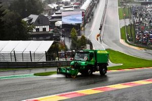 A truck sweeps water from the circuit