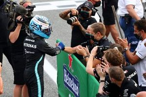 Pole man Valtteri Bottas, Mercedes, celebrates with his team on arrival in Parc Ferme